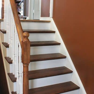 Stairway Remodel Part 4: Painting Spindles, Risers, and Using Polyurethane (Mini-Reveal!)