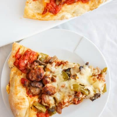 Sausage Pizza with Onions, Green Peppers, and Bacon