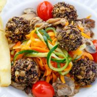 Lentil Meatballs over Vegetable Noodles in a Basil-Mushroom Sauce